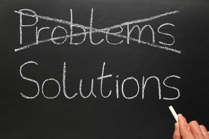Crossing out problems and writing solutions on a blackboard.